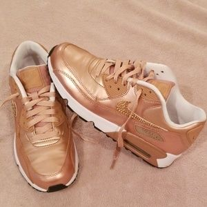 Rose gold Nike running shoes with crystal swoosh